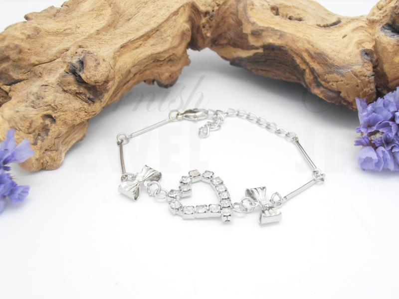 Silver Plated Diamante Heart Bracelet With Bows